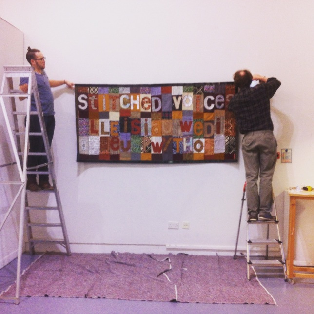 Hanging the title quilt